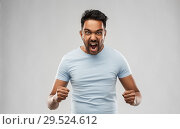Купить «angry indian man screaming over grey background», фото № 29524612, снято 27 октября 2018 г. (c) Syda Productions / Фотобанк Лори