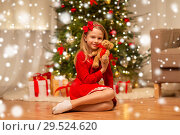 Купить «girl in red dress hugging teddy bear at home», фото № 29524620, снято 22 декабря 2017 г. (c) Syda Productions / Фотобанк Лори