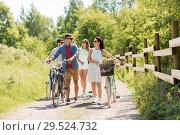 Купить «happy friends with fixed gear bicycles in summer», фото № 29524732, снято 7 июля 2018 г. (c) Syda Productions / Фотобанк Лори