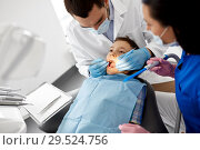 Купить «dentist checking for kid teeth at dental clinic», фото № 29524756, снято 22 апреля 2018 г. (c) Syda Productions / Фотобанк Лори