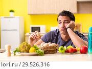 Купить «Young man in dieting and healthy eating concept», фото № 29526316, снято 19 июня 2018 г. (c) Elnur / Фотобанк Лори