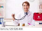 Купить «Young doctor with first aid kit in hospital», фото № 29528408, снято 23 августа 2018 г. (c) Elnur / Фотобанк Лори
