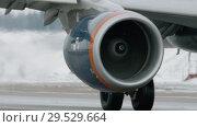 Купить «Jet plane on a snowy runway - detail», видеоролик № 29529664, снято 12 декабря 2018 г. (c) Данил Руденко / Фотобанк Лори