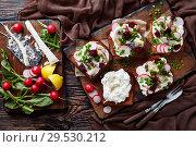 Купить «Smorrebrod with fish - danish open faced sandwich», фото № 29530212, снято 1 декабря 2018 г. (c) Oksana Zh / Фотобанк Лори