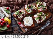 Купить «Smorrebrod with fish - danish open faced sandwich», фото № 29530216, снято 1 декабря 2018 г. (c) Oksana Zh / Фотобанк Лори