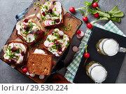 Купить «danish open faced sandwiches and beer», фото № 29530224, снято 1 декабря 2018 г. (c) Oksana Zh / Фотобанк Лори