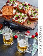 Купить «danish open faced sandwiches and beer», фото № 29530228, снято 1 декабря 2018 г. (c) Oksana Zh / Фотобанк Лори
