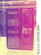 Купить «Closeup of hardware of data center», фото № 29530504, снято 15 января 2018 г. (c) Яков Филимонов / Фотобанк Лори