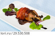 Купить «Baked in bacon small quail with balsamic sauce, served with lettuce», фото № 29530508, снято 17 января 2019 г. (c) Яков Филимонов / Фотобанк Лори