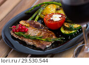 Купить «Roasted veal steak with vegetables and redcurrant on wooden surface», фото № 29530544, снято 27 июня 2018 г. (c) Яков Филимонов / Фотобанк Лори