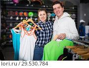 Купить «Couple demonstraiting new sportwear», фото № 29530784, снято 7 февраля 2018 г. (c) Яков Филимонов / Фотобанк Лори