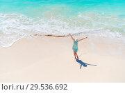 Купить «Happy girl at beach having a lot of fun in shallow water», фото № 29536692, снято 9 апреля 2017 г. (c) Дмитрий Травников / Фотобанк Лори