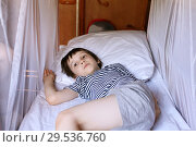 Little boy resting in the  train compartment. Стоковое фото, фотограф ivolodina / Фотобанк Лори