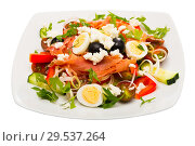 Купить «Salad with salmon, fresh tomato, cucumber and quail eggs at plate», фото № 29537264, снято 11 декабря 2018 г. (c) Яков Филимонов / Фотобанк Лори