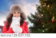Купить «woman with coffee over christmas tree in tallinn», фото № 29537732, снято 7 января 2017 г. (c) Syda Productions / Фотобанк Лори