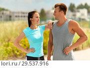Купить «happy couple in sports clothes outdoors», фото № 29537916, снято 1 августа 2018 г. (c) Syda Productions / Фотобанк Лори