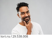 Купить «smiling indian man touching his beard», фото № 29538008, снято 27 октября 2018 г. (c) Syda Productions / Фотобанк Лори