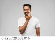 Купить «happy indian man applying cream to face», фото № 29538016, снято 27 октября 2018 г. (c) Syda Productions / Фотобанк Лори
