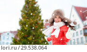 Купить «happy woman over christmas tree in tallinn», фото № 29538064, снято 7 января 2017 г. (c) Syda Productions / Фотобанк Лори