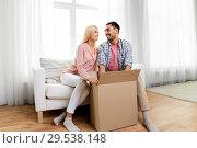 Купить «happy couple with open parcel box at home», фото № 29538148, снято 6 июня 2015 г. (c) Syda Productions / Фотобанк Лори