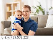 Купить «happy baby boy with father at home», фото № 29538228, снято 5 мая 2018 г. (c) Syda Productions / Фотобанк Лори