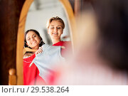 Купить «women choosing clothes at vintage clothing store», фото № 29538264, снято 7 августа 2018 г. (c) Syda Productions / Фотобанк Лори