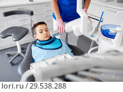 Купить «dentist making x-ray of kid teeth at dental clinic», фото № 29538288, снято 22 апреля 2018 г. (c) Syda Productions / Фотобанк Лори