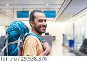 man with backpack over airport terminal. Стоковое фото, фотограф Syda Productions / Фотобанк Лори