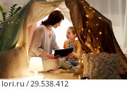 Купить «family with tablet pc in kids tent at home», фото № 29538412, снято 27 января 2018 г. (c) Syda Productions / Фотобанк Лори