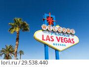 Купить «welcome to fabulous las vegas sign and palm trees», фото № 29538440, снято 2 марта 2018 г. (c) Syda Productions / Фотобанк Лори