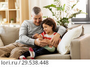 Купить «happy father with preteen and baby son at home», фото № 29538448, снято 14 апреля 2018 г. (c) Syda Productions / Фотобанк Лори