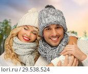 Купить «couple hugging over winter forest background», фото № 29538524, снято 7 октября 2012 г. (c) Syda Productions / Фотобанк Лори