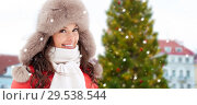 Купить «happy woman over christmas tree in tallinn», фото № 29538544, снято 7 января 2017 г. (c) Syda Productions / Фотобанк Лори