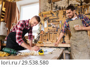 Купить «carpenters with ruler and coffee at workshop», фото № 29538580, снято 14 мая 2016 г. (c) Syda Productions / Фотобанк Лори