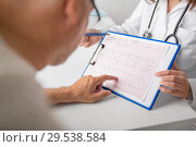 senior man and doctor with cardiogram at hospital. Стоковое фото, фотограф Syda Productions / Фотобанк Лори