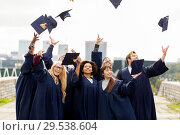 Купить «happy graduates or students throwing mortar boards», фото № 29538604, снято 24 сентября 2016 г. (c) Syda Productions / Фотобанк Лори