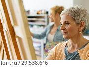 Купить «senior woman drawing on easel at art school studio», фото № 29538616, снято 26 мая 2017 г. (c) Syda Productions / Фотобанк Лори