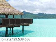 Купить «bungalow huts of resort in french polynesia», фото № 29538656, снято 16 февраля 2018 г. (c) Syda Productions / Фотобанк Лори