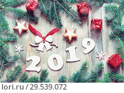 Купить «New Year 2019 festive background with 2019 figures, Christmas toys, blue fir tree branches and snowflakes», фото № 29539072, снято 29 ноября 2016 г. (c) Зезелина Марина / Фотобанк Лори