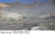 Купить «Volcanic landscape aggressive natural hot springs, vapor surrounded by fumaroles», видеоролик № 29539312, снято 26 сентября 2018 г. (c) А. А. Пирагис / Фотобанк Лори