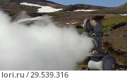 Купить «Emission of thermal steam-water mixture from well in geothermal deposit area», видеоролик № 29539316, снято 26 сентября 2018 г. (c) А. А. Пирагис / Фотобанк Лори