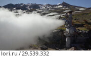 Купить «Emission of thermal water, steam from geological well in geothermal deposit area», видеоролик № 29539332, снято 26 сентября 2018 г. (c) А. А. Пирагис / Фотобанк Лори