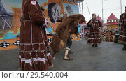 Купить «Women dancing in national clothing indigenous inhabitants Kamchatka», видеоролик № 29540004, снято 4 ноября 2018 г. (c) А. А. Пирагис / Фотобанк Лори