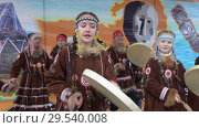 Купить «Girls in national clothing indigenous Kamchatka dancing and beats tambourine», видеоролик № 29540008, снято 4 ноября 2018 г. (c) А. А. Пирагис / Фотобанк Лори
