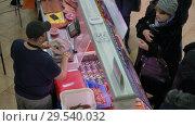 Купить «Top view of fish market trading department, woman buys squid», видеоролик № 29540032, снято 2 декабря 2018 г. (c) А. А. Пирагис / Фотобанк Лори