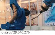 Купить «Blue industrial machine doing its work. A Lathe», видеоролик № 29540276, снято 16 июля 2019 г. (c) Константин Шишкин / Фотобанк Лори