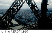 Купить «Closeup of metal girders and framing constructions of famous Eiffel Tower in Paris», видеоролик № 29541980, снято 27 октября 2018 г. (c) Яков Филимонов / Фотобанк Лори