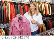 Купить «Portrait of glad woman customer with leather jackets in store», фото № 29542740, снято 5 сентября 2018 г. (c) Яков Филимонов / Фотобанк Лори