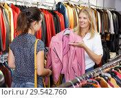 Купить «Two women in leather clothes shop», фото № 29542760, снято 5 сентября 2018 г. (c) Яков Филимонов / Фотобанк Лори