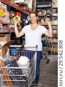 Купить «Woman customer in build store», фото № 29542808, снято 20 сентября 2018 г. (c) Яков Филимонов / Фотобанк Лори